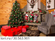 Gift boxes, decorated christmas tree and fireplace. Стоковое фото, фотограф Tryapitsyn Sergiy / Фотобанк Лори