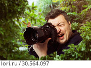 Photographer at work, butterfly on camera lens. Стоковое фото, фотограф Tryapitsyn Sergiy / Фотобанк Лори