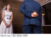 Groom making a proposal of marriage to the bride. Стоковое фото, фотограф Tryapitsyn Sergiy / Фотобанк Лори