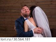 Happy newlyweds embracing after marriage proposal. Стоковое фото, фотограф Tryapitsyn Sergiy / Фотобанк Лори
