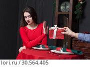 Купить «Shy woman refuses gift in restaurant», фото № 30564405, снято 26 декабря 2016 г. (c) Tryapitsyn Sergiy / Фотобанк Лори
