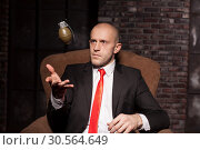 Купить «Murderer in suit and red tie tosses a grenade up», фото № 30564649, снято 19 января 2017 г. (c) Tryapitsyn Sergiy / Фотобанк Лори