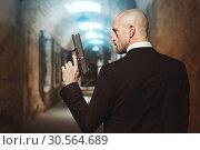 Купить «Contract killer wallpaper concept, back view», фото № 30564689, снято 19 января 2017 г. (c) Tryapitsyn Sergiy / Фотобанк Лори