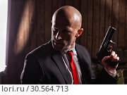 Contract assassin, wallpaper, background or poster. Стоковое фото, фотограф Tryapitsyn Sergiy / Фотобанк Лори