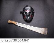 Купить «Murderer hockey mask and machete isolated on black», фото № 30564841, снято 25 января 2017 г. (c) Tryapitsyn Sergiy / Фотобанк Лори