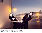 Mime actor and actress performing with suitcase. Стоковое фото, фотограф Tryapitsyn Sergiy / Фотобанк Лори