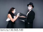 Купить «Pantomime actors comedy performing with case», фото № 30565149, снято 12 февраля 2017 г. (c) Tryapitsyn Sergiy / Фотобанк Лори