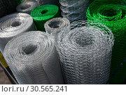 Купить «Barbed wire and mesh netting rolls», фото № 30565241, снято 21 февраля 2017 г. (c) Tryapitsyn Sergiy / Фотобанк Лори