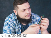 Service engineer fixing problem with pc hardware. Стоковое фото, фотограф Tryapitsyn Sergiy / Фотобанк Лори