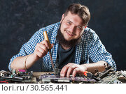 Repairman fixing problem with soldering tool. Стоковое фото, фотограф Tryapitsyn Sergiy / Фотобанк Лори