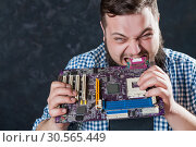 Service engineer repair computer motherboard. Стоковое фото, фотограф Tryapitsyn Sergiy / Фотобанк Лори
