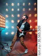 Купить «Male solo guitarist with electro guitar», фото № 30565509, снято 2 марта 2017 г. (c) Tryapitsyn Sergiy / Фотобанк Лори