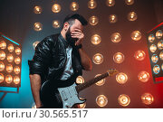 Male musican with electro guitar solo concert. Стоковое фото, фотограф Tryapitsyn Sergiy / Фотобанк Лори