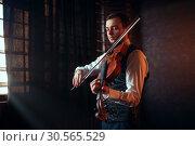 Купить «Male fiddler playing classical music on violin», фото № 30565529, снято 4 марта 2017 г. (c) Tryapitsyn Sergiy / Фотобанк Лори