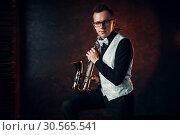 Male saxophonist playing classical jazz on sax. Стоковое фото, фотограф Tryapitsyn Sergiy / Фотобанк Лори