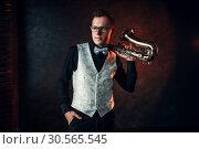 Купить «Male jazz man posing with saxophone», фото № 30565545, снято 4 марта 2017 г. (c) Tryapitsyn Sergiy / Фотобанк Лори