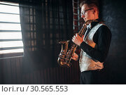 Male saxophonist with saxophone, jazz man with sax. Стоковое фото, фотограф Tryapitsyn Sergiy / Фотобанк Лори