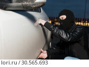 Купить «Male thief trying to open car door», фото № 30565693, снято 17 марта 2017 г. (c) Tryapitsyn Sergiy / Фотобанк Лори
