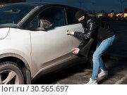Купить «Carjacking danger, car insurance concept», фото № 30565697, снято 17 марта 2017 г. (c) Tryapitsyn Sergiy / Фотобанк Лори