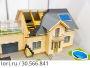 Model of house, thermal insulation of roof concept. Стоковое фото, фотограф Tryapitsyn Sergiy / Фотобанк Лори