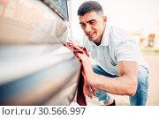 Купить «Car exterior polishing on carwash station», фото № 30566997, снято 31 мая 2017 г. (c) Tryapitsyn Sergiy / Фотобанк Лори