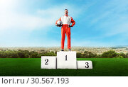 Купить «Karting racer on winner podium go kart competition», фото № 30567193, снято 15 июня 2017 г. (c) Tryapitsyn Sergiy / Фотобанк Лори