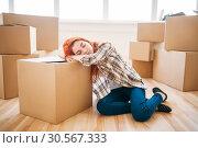 Купить «Woman sleeps on carton box, moving to new house», фото № 30567333, снято 29 июня 2017 г. (c) Tryapitsyn Sergiy / Фотобанк Лори