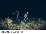Купить «Maniac with bloody baseball bat try to kill victim», фото № 30568481, снято 22 сентября 2017 г. (c) Tryapitsyn Sergiy / Фотобанк Лори