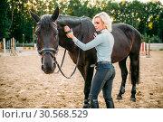 Купить «Woman take caring for the hair of brown horse», фото № 30568529, снято 17 сентября 2017 г. (c) Tryapitsyn Sergiy / Фотобанк Лори