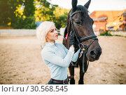 Купить «Female rider hugs her horse, horseback riding», фото № 30568545, снято 17 сентября 2017 г. (c) Tryapitsyn Sergiy / Фотобанк Лори