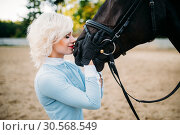 Woman hugs her horse, friendship, horseback riding. Стоковое фото, фотограф Tryapitsyn Sergiy / Фотобанк Лори