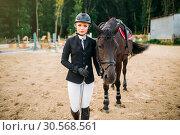 Купить «Equestrian sport, female jockey and horse», фото № 30568561, снято 17 сентября 2017 г. (c) Tryapitsyn Sergiy / Фотобанк Лори