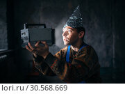 Paranoid man in tinfoil cap, mind protection, UFO. Стоковое фото, фотограф Tryapitsyn Sergiy / Фотобанк Лори