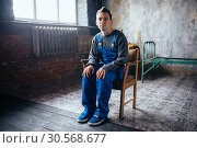 Купить «Crasy man sitting in the chair, psycho patient», фото № 30568677, снято 1 октября 2017 г. (c) Tryapitsyn Sergiy / Фотобанк Лори
