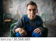 Купить «Madman, mouth sealed with plaster, psycho patient», фото № 30568685, снято 1 октября 2017 г. (c) Tryapitsyn Sergiy / Фотобанк Лори