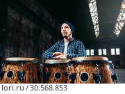 Male drummer plays on wooden drum. Стоковое фото, фотограф Tryapitsyn Sergiy / Фотобанк Лори