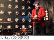 Купить «Bearded drummer in red suit on the stage», фото № 30569061, снято 10 ноября 2017 г. (c) Tryapitsyn Sergiy / Фотобанк Лори