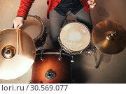Купить «Drummer in red suit, top view, vintage style», фото № 30569077, снято 10 ноября 2017 г. (c) Tryapitsyn Sergiy / Фотобанк Лори
