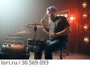 Купить «Bearded drummer with colorful hair, rock performer», фото № 30569093, снято 10 ноября 2017 г. (c) Tryapitsyn Sergiy / Фотобанк Лори