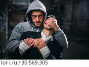 Thief with knife attack his victim on night street. Стоковое фото, фотограф Tryapitsyn Sergiy / Фотобанк Лори