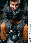 Stalker with gas mask, post apocalyptic lifestyle. Стоковое фото, фотограф Tryapitsyn Sergiy / Фотобанк Лори