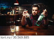 Купить «Alcoholic sitting at the bar counter, drunkenness», фото № 30569885, снято 20 декабря 2017 г. (c) Tryapitsyn Sergiy / Фотобанк Лори