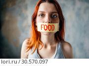 Купить «Womans face, mouth sealed with tape labeled food», фото № 30570097, снято 10 января 2018 г. (c) Tryapitsyn Sergiy / Фотобанк Лори