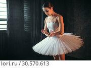 Ballerina dancing in studio against window. Стоковое фото, фотограф Tryapitsyn Sergiy / Фотобанк Лори