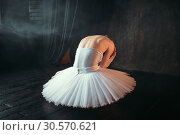 Ballet dancer sitting on stage, back view. Стоковое фото, фотограф Tryapitsyn Sergiy / Фотобанк Лори