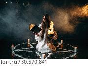 Купить «Witch in pentagram circle, dark magic ritual», фото № 30570841, снято 27 февраля 2018 г. (c) Tryapitsyn Sergiy / Фотобанк Лори