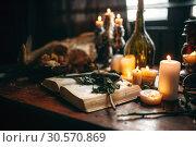 Купить «Witchcraft, dark magic, candles with ritual book», фото № 30570869, снято 27 февраля 2018 г. (c) Tryapitsyn Sergiy / Фотобанк Лори