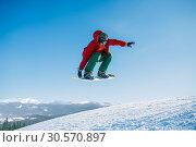 Купить «Snowboarder makes a jump on speed slope», фото № 30570897, снято 6 марта 2018 г. (c) Tryapitsyn Sergiy / Фотобанк Лори