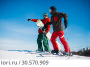 Купить «Downhill skiing, skiers on the top of slope», фото № 30570909, снято 6 марта 2018 г. (c) Tryapitsyn Sergiy / Фотобанк Лори