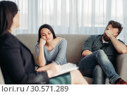 Stressed couple patients at psychologist reception. Стоковое фото, фотограф Tryapitsyn Sergiy / Фотобанк Лори